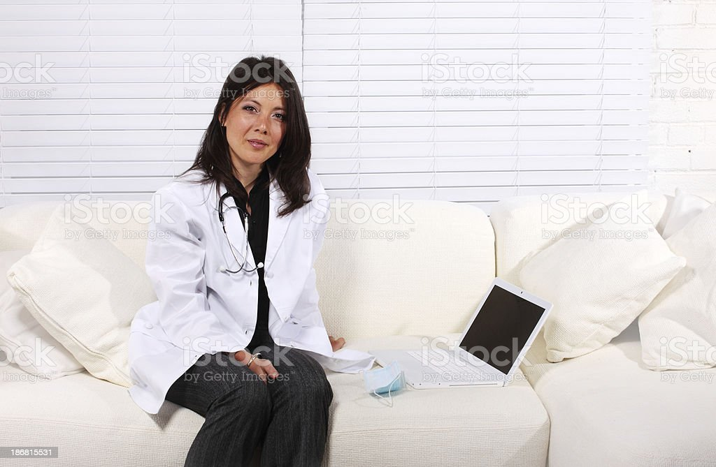 Young female doctor working on laptop royalty-free stock photo