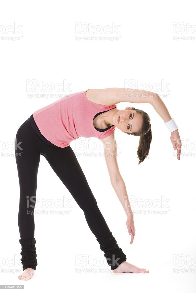young female doing some exercises on white floor, isolated stock photo