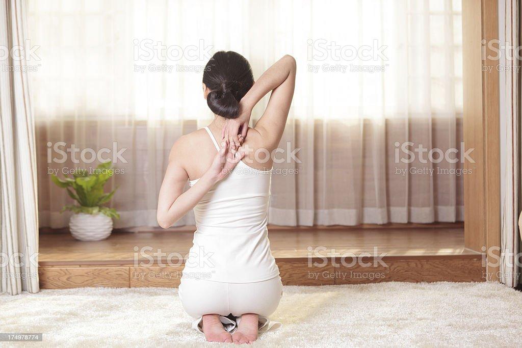 Young female doing yoga exercise royalty-free stock photo