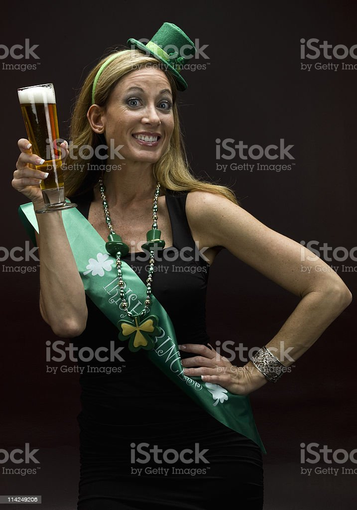 Young female dressed as an Irish princess with beer in hand royalty-free stock photo
