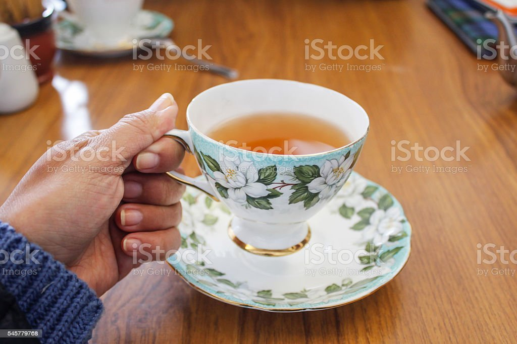 Young female drinking a cup of hot tea stock photo