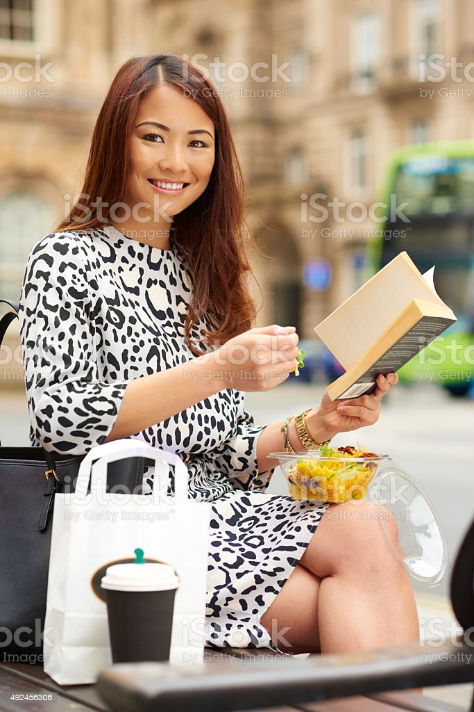 Young female eating her dinner on her lunchbreak stock photo