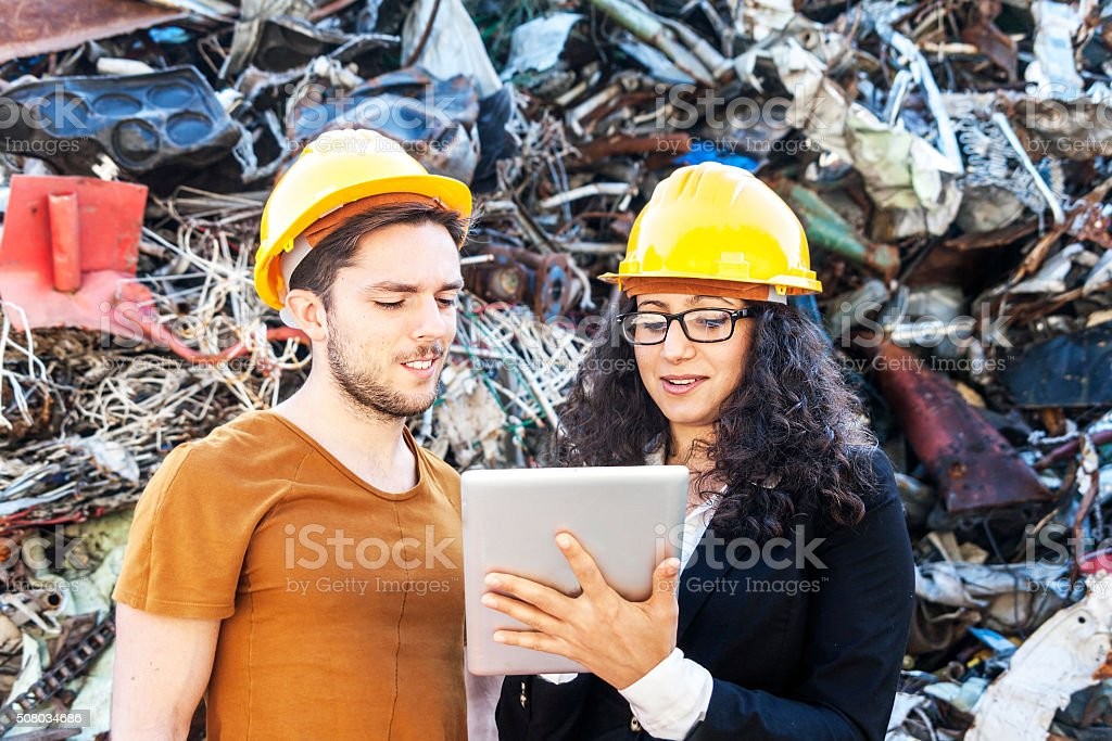 young female engineer plans the work with a collaborator stock photo