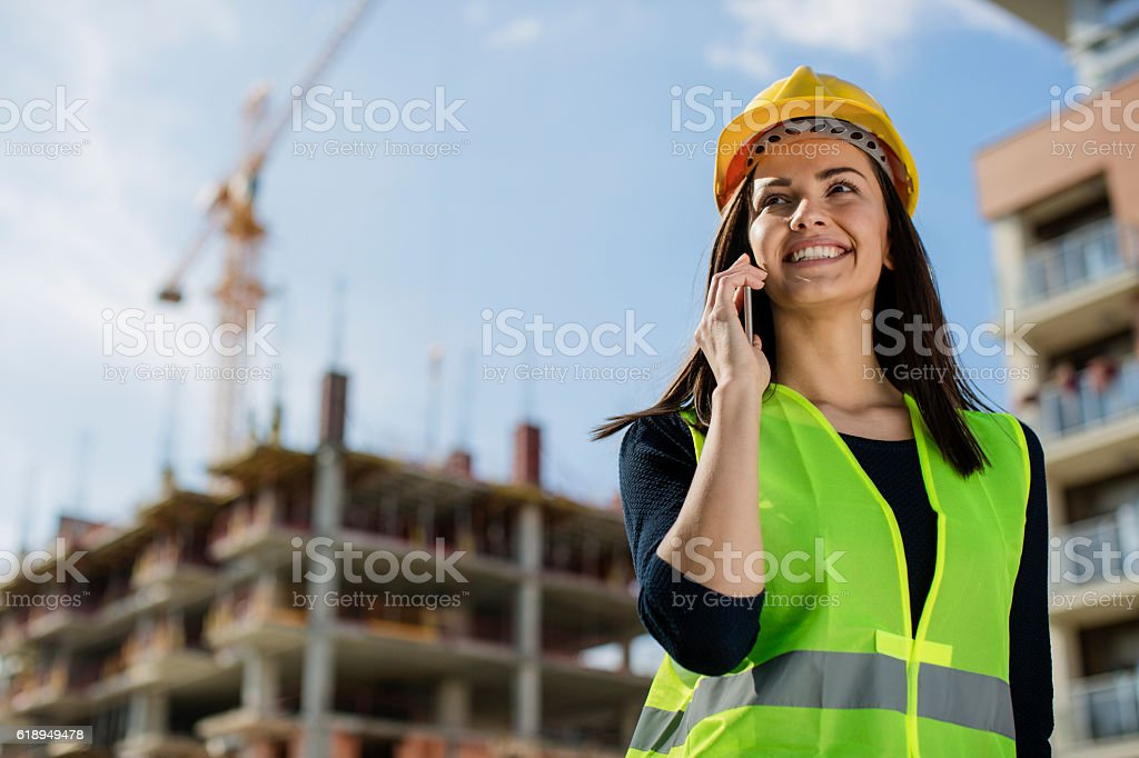Young female engineer talking on a phone stock photo