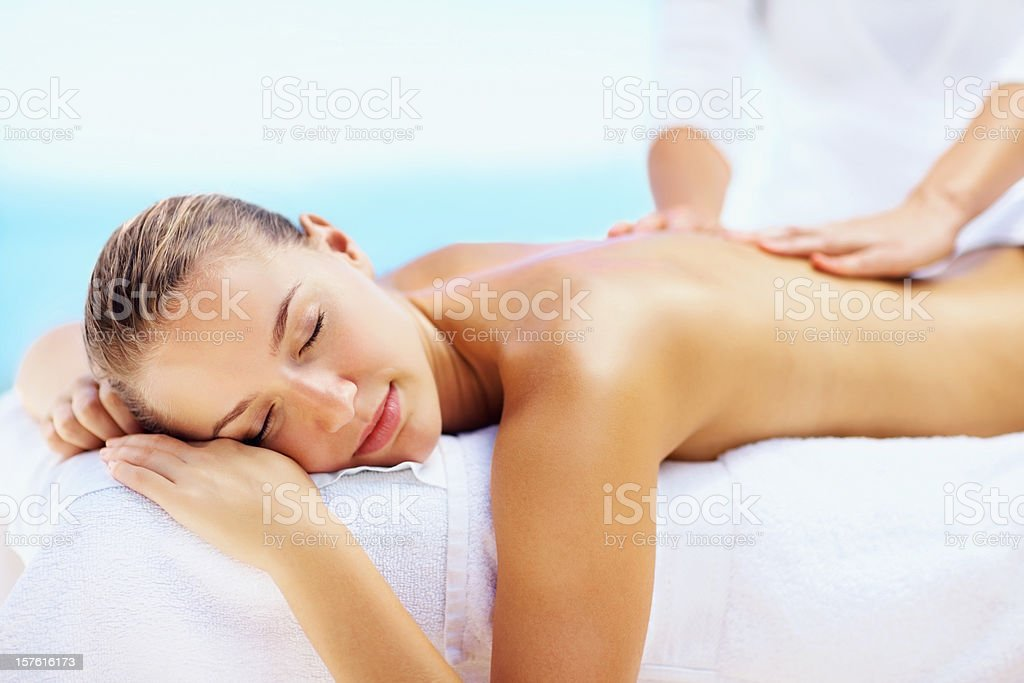 Young female enjoying a body massage royalty-free stock photo