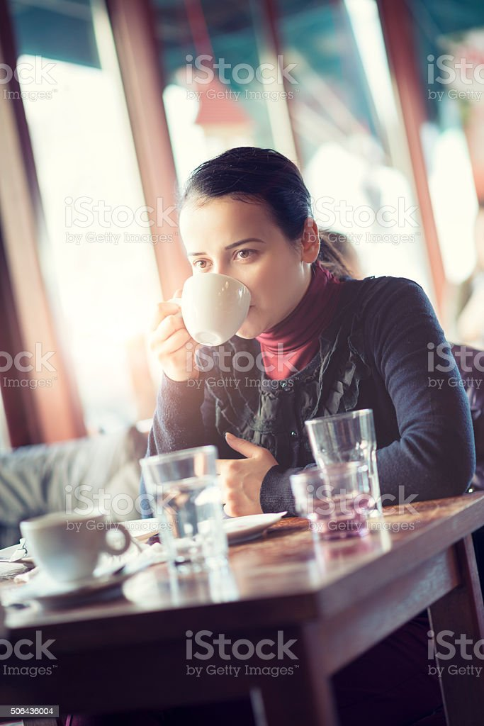 Young Female Enjoying Coffee Break at the Restaurant stock photo