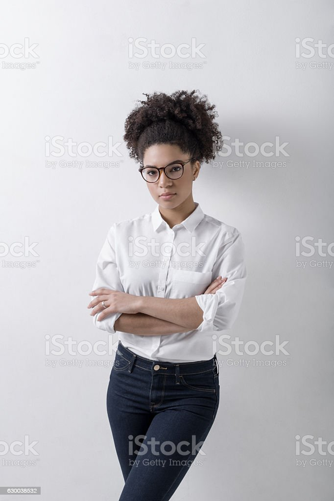 Young female entrepreneur standing at wall stock photo