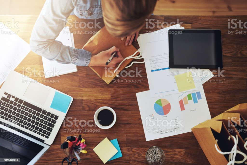 Young female entrepreneur working in a home office stock photo