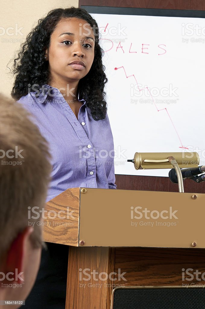 Young female executive presents bad sales results - V royalty-free stock photo