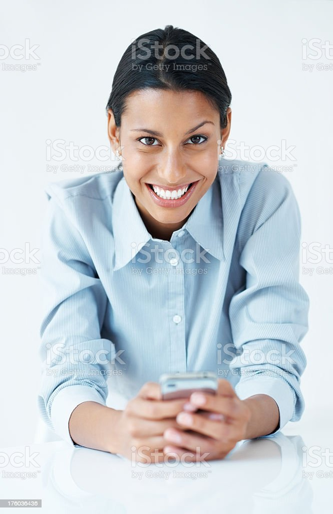Young female executive texting on mobile phone stock photo