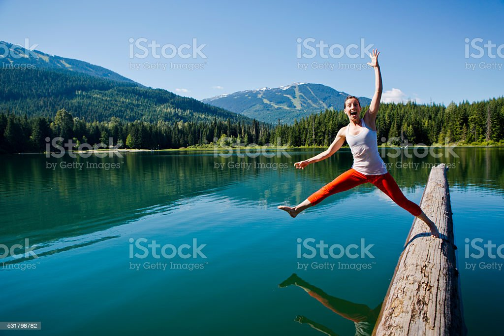 Young female falling into lake. stock photo