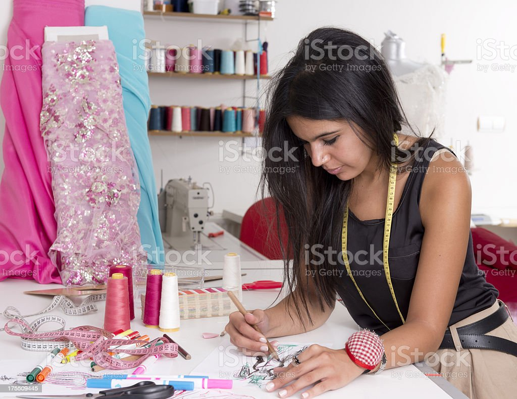 Young female fashion designer working on her next design stock photo