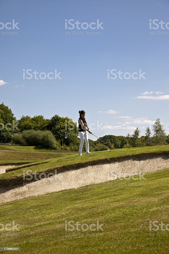 young female golf professional short game royalty-free stock photo
