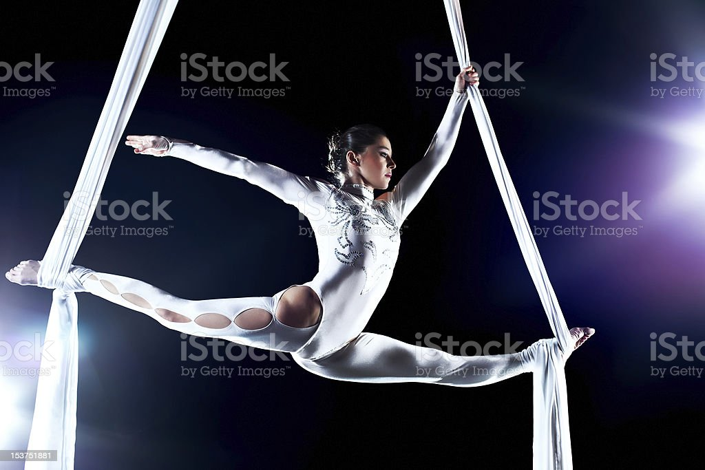 A young female gymnast on silks stock photo