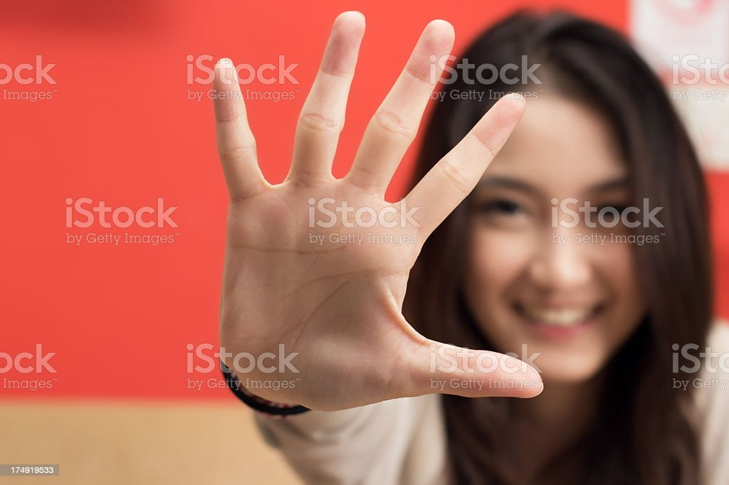 Young female hand show five fingers. royalty-free stock photo
