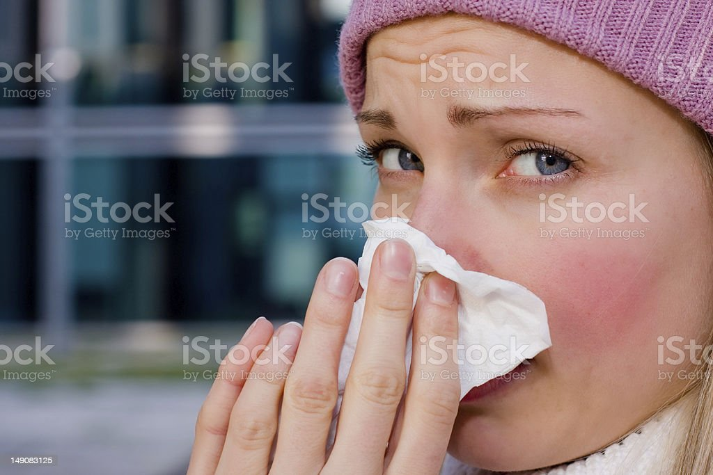 young female having a cold stock photo