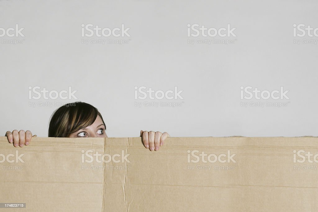 Young female hiding royalty-free stock photo