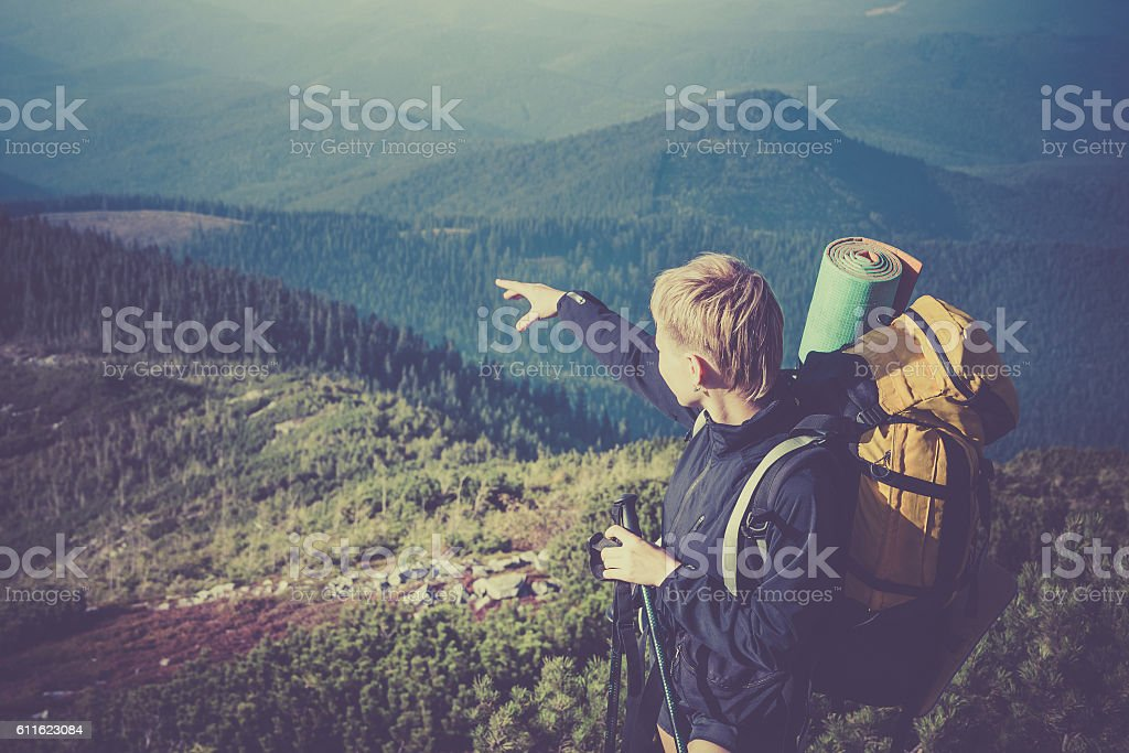 Young female hiker in the mountains. stock photo
