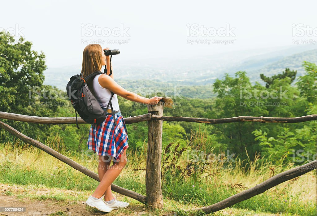 Young female hiker with backpack stock photo