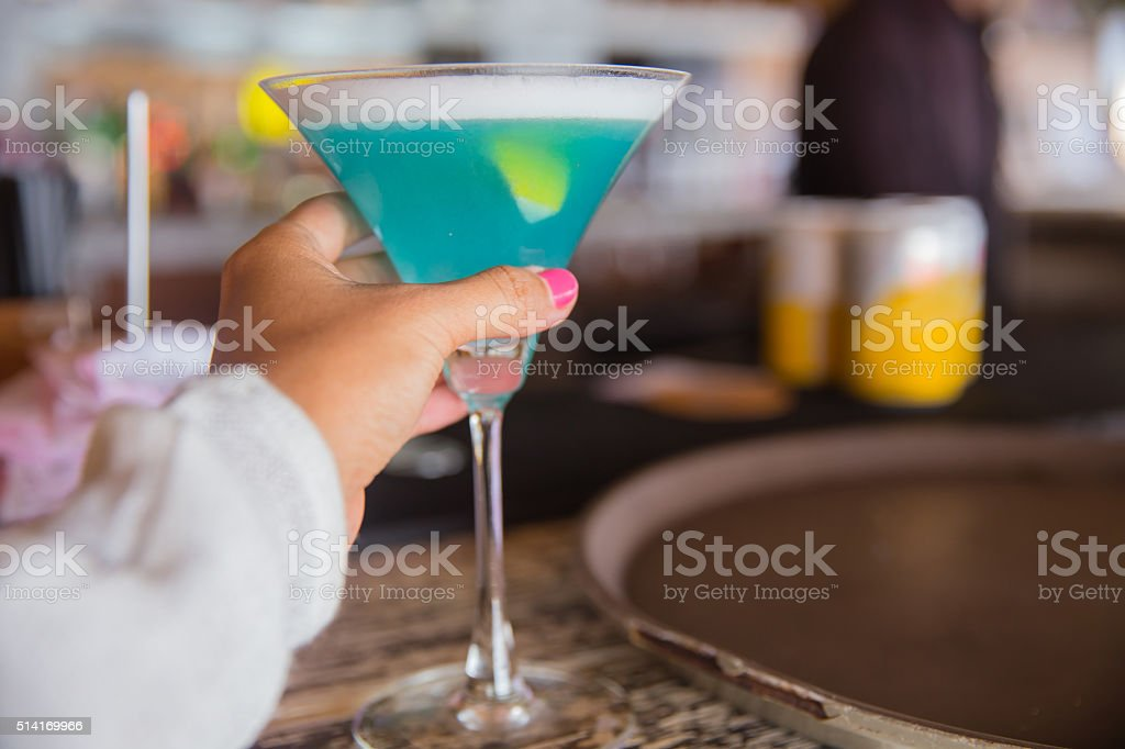 Young female holding cocktail stock photo