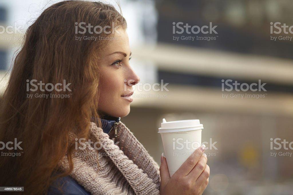 Young female holding coffee cup stock photo