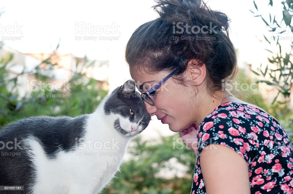 Young female holding her loving cat stock photo
