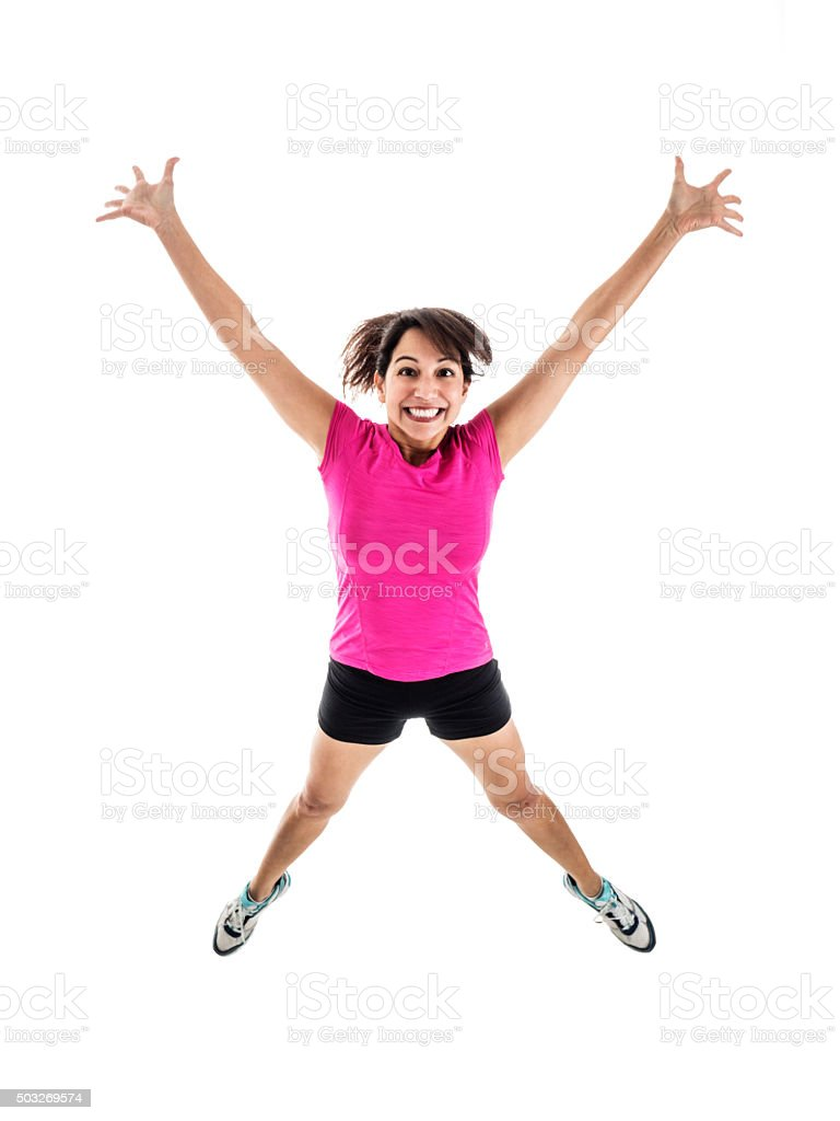 Young Female in Workout Wear Jumping for Joy stock photo