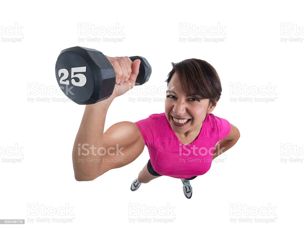 Young Female in Workout Wear Lifting Dumbbell and Flexing Muscle stock photo