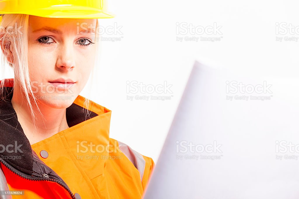 Young female industrial laborer with drawing stock photo
