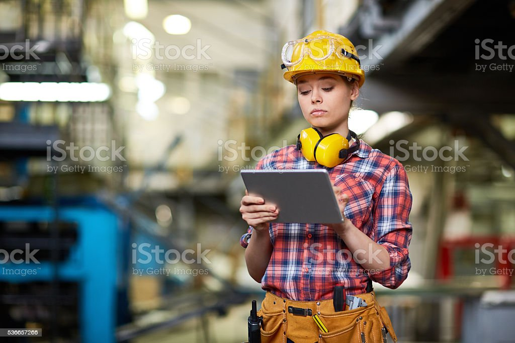Young female inspector stock photo