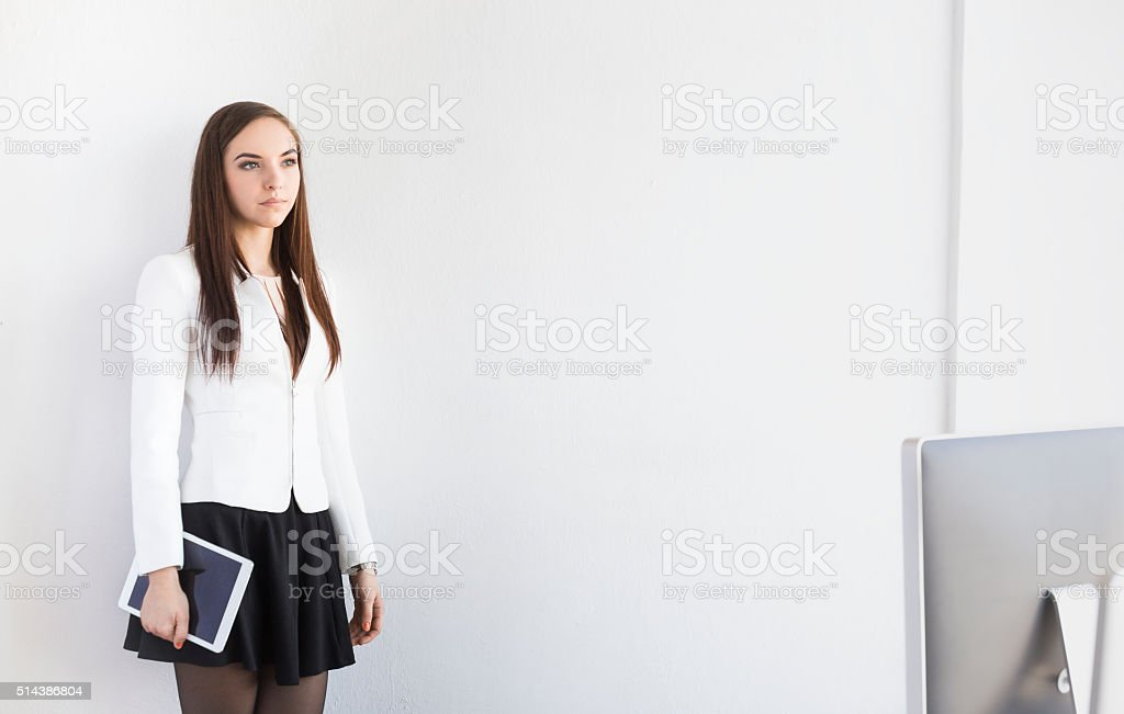Young Female Intern with Digital Tablet In The Office stock photo