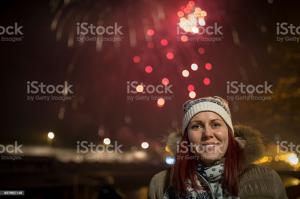 Young female is celebrating New Year. stock photo