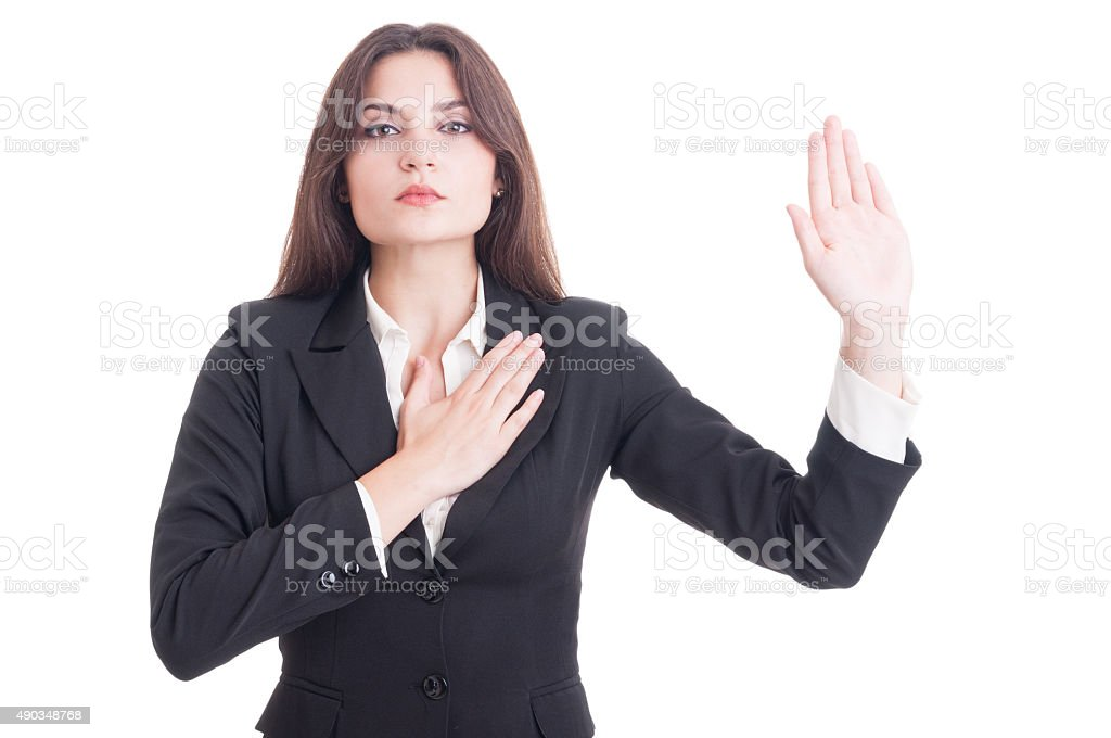 Young female lawyer making oath gesture with hand on heart stock photo