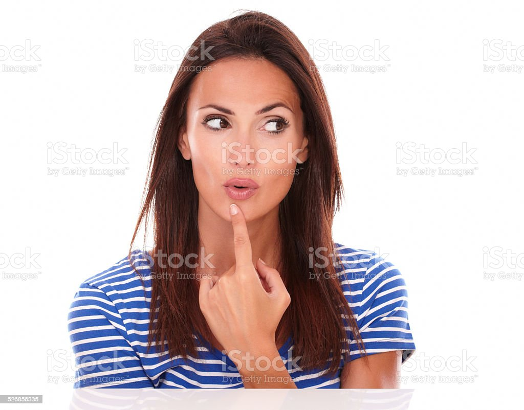 Young female looking to her left wondering stock photo