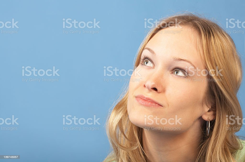 Young female lost in deep thought royalty-free stock photo