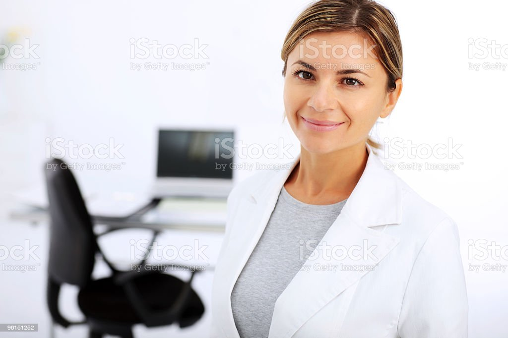 Young female manager standing in the office. royalty-free stock photo