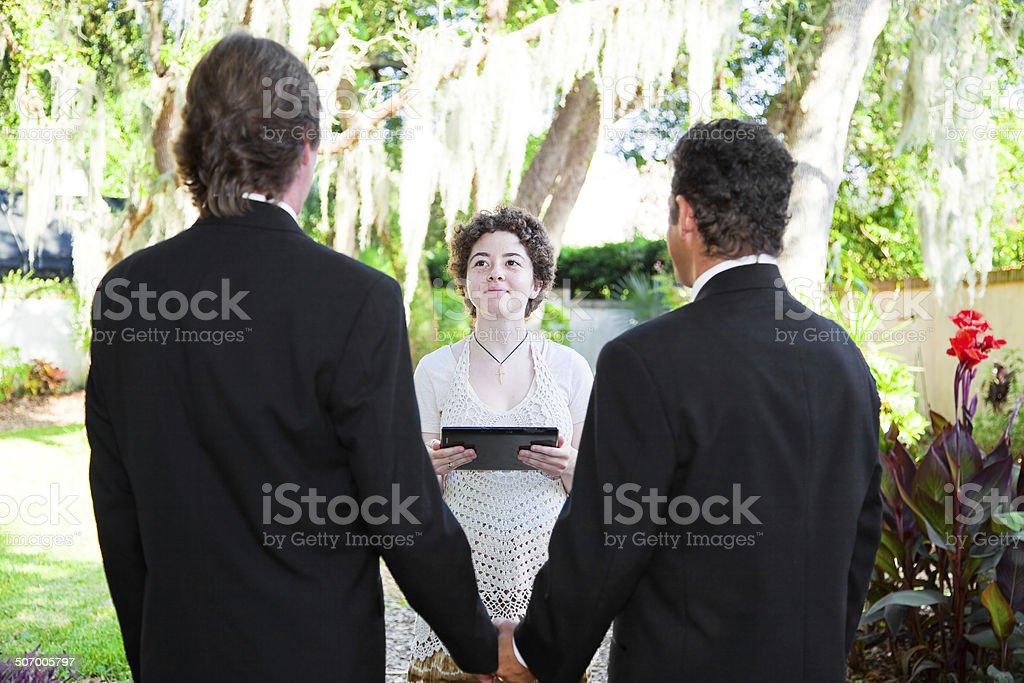 Young Female Minister Marries Gay Couple stock photo