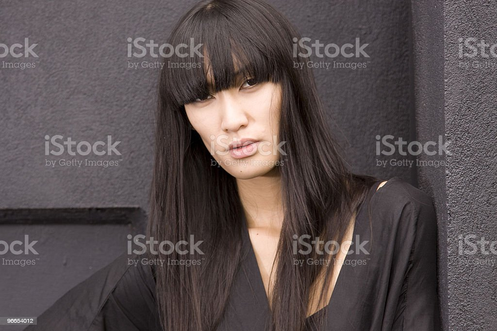 Young female model in black stock photo