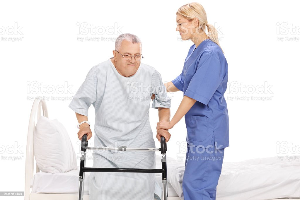 Young female nurse assisting a senior patient stock photo