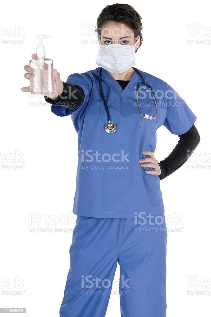 Young female nurse, wearing mask, stethoscope, offering hand sanitizer, isolated stock photo