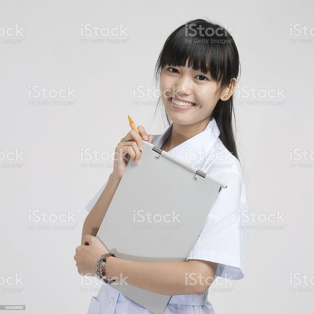 Young Female Nurse Writing, Studio Portrait royalty-free stock photo
