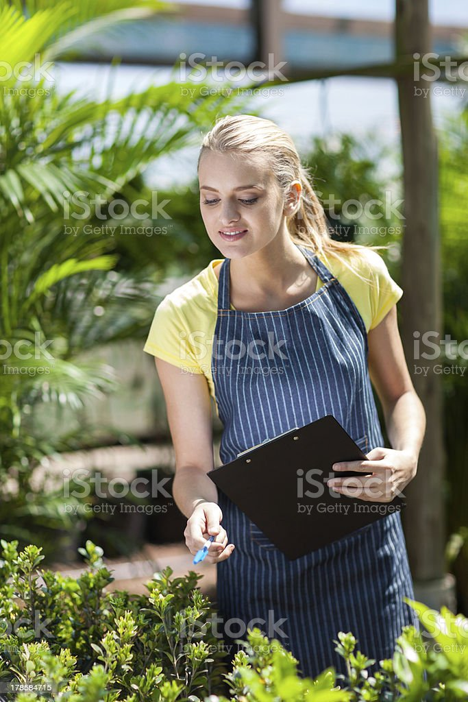 young female nursery worker counting stock royalty-free stock photo