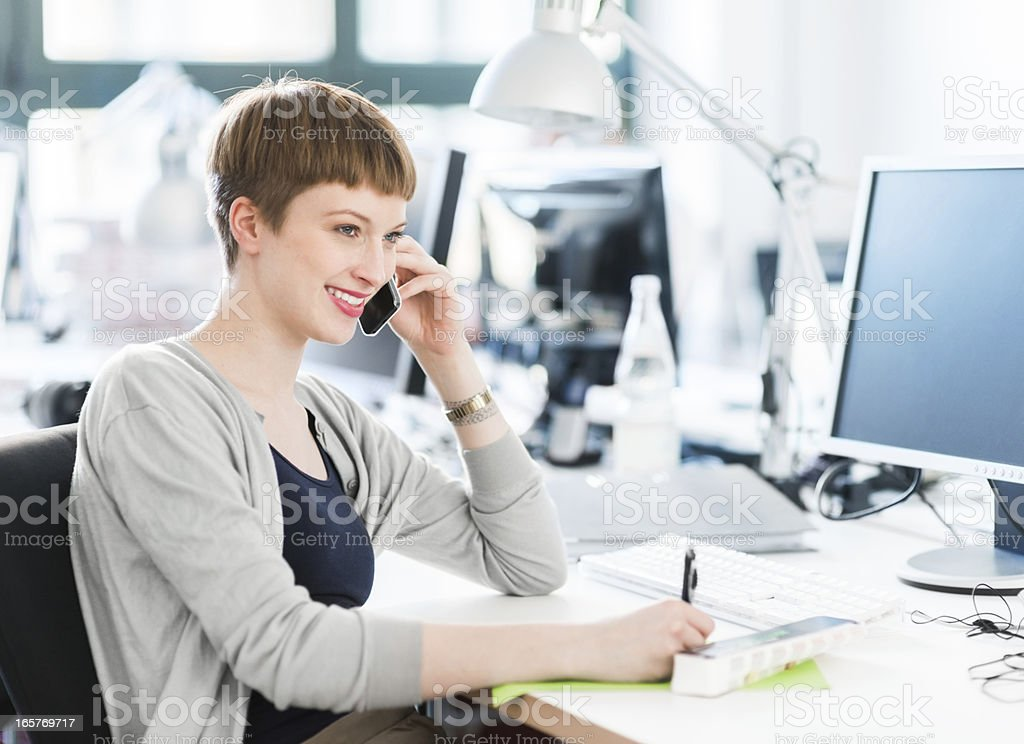 Young Female Office Worker With Smart Phone stock photo