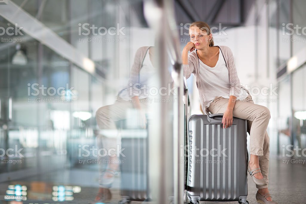 Young female passenger at the airport stock photo
