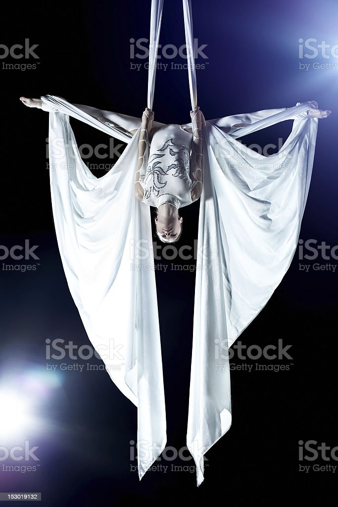 A young female performing as a gymnast at a show stock photo