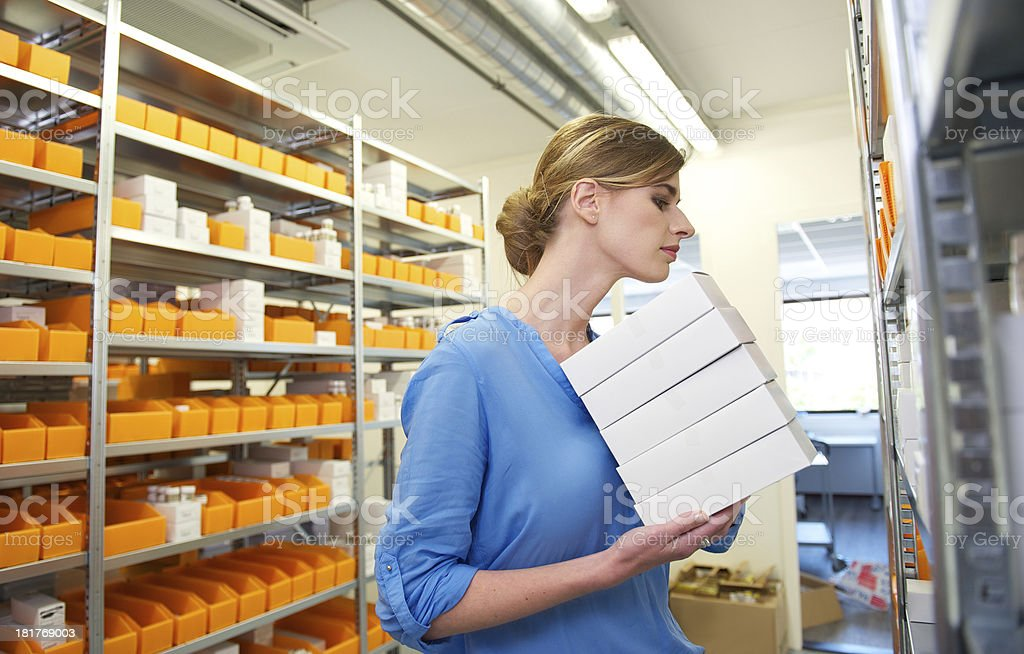 Young female pharmacist searching for medicine royalty-free stock photo
