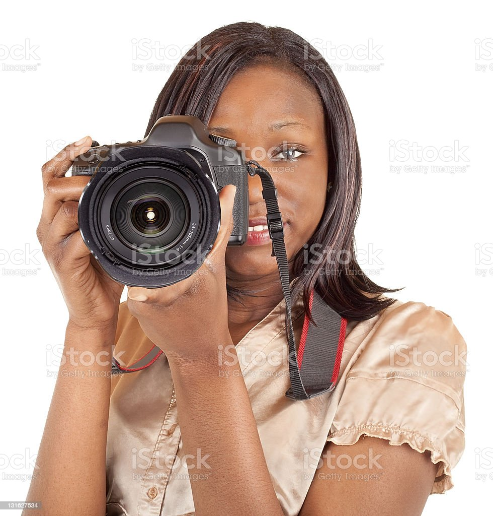 A young female photographer holding a camera royalty-free stock photo