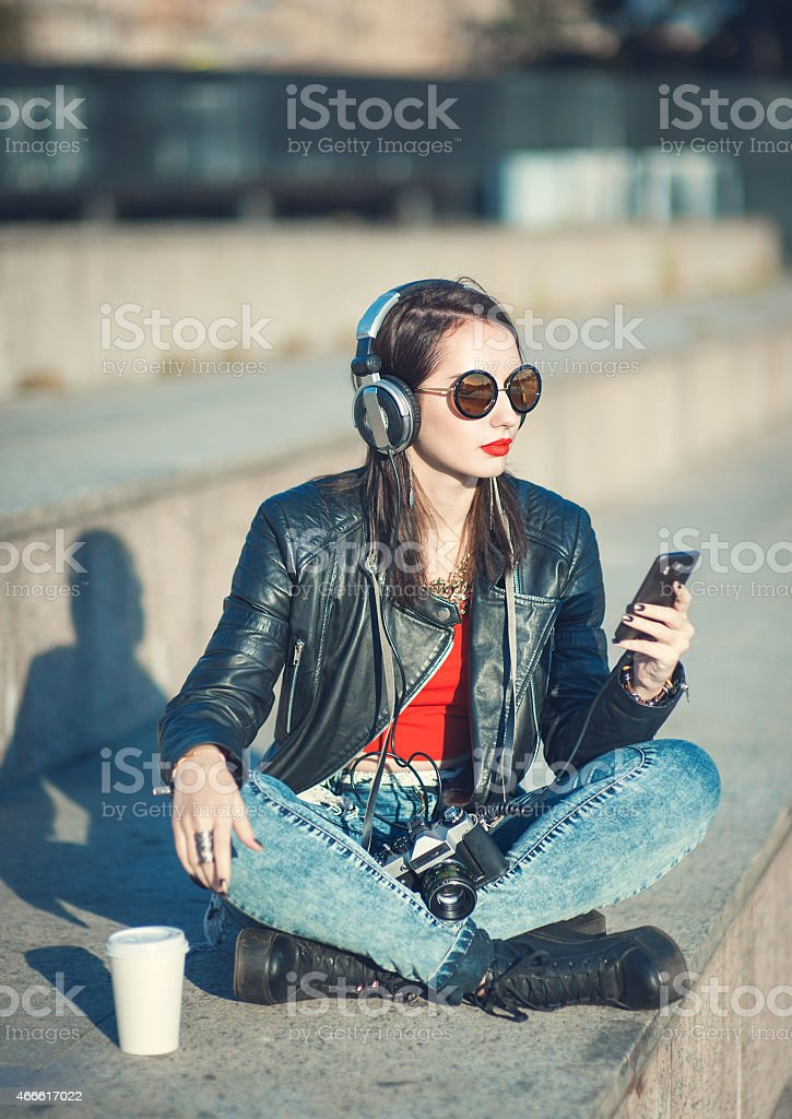 Young female photographer in jeans and leather jacket stock photo