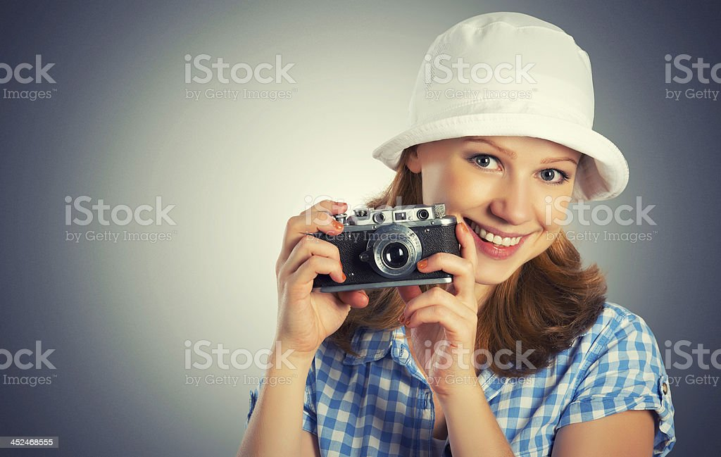 young female photographer with retro camera royalty-free stock photo
