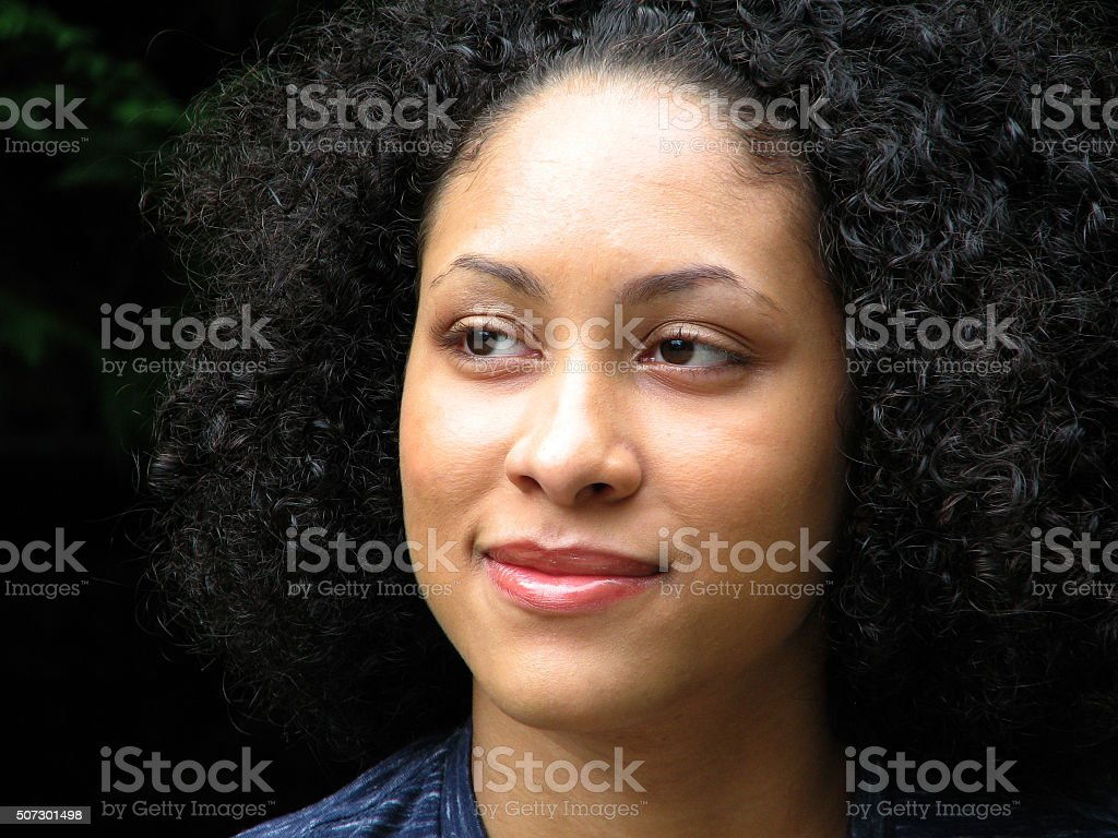 young female Puerto Rican  head shot 3/4 view stock photo